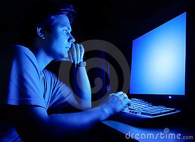 Man In Front Of Computer Screen Royalty Free Stock Photos