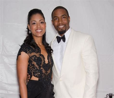 Michael Jai White and wife Courtenay Chatman attend the