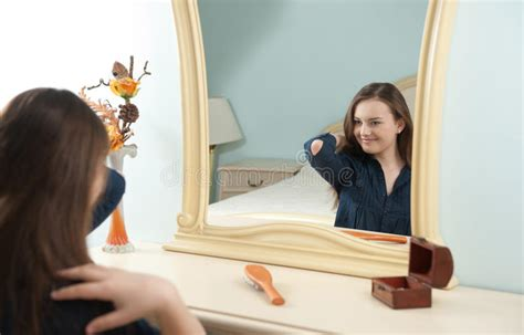 Young Girl In Front Of Mirror Stock Image - Image of comb